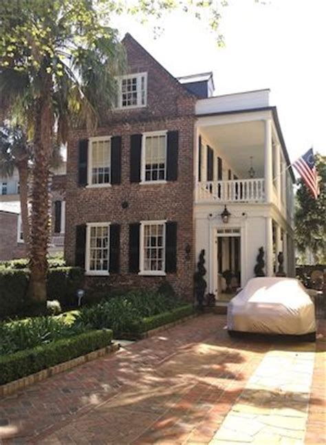 gorgeous charleston style home in summerville white porch red brick houses and brick houses on pinterest