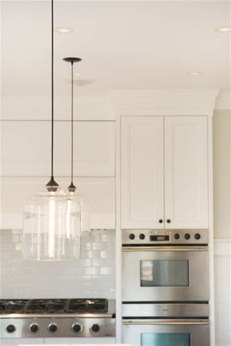 Pendant Lighting For Kitchen A Lovely Melbourne Kitchen With A Striking Iron Glass Pendant Light And Amish Made Cabinetry