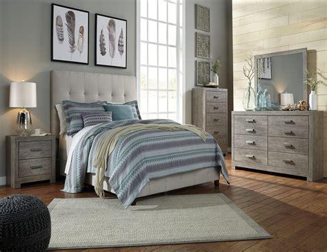contemporary beige upholstered panel bedroom set  ashley coleman furniture