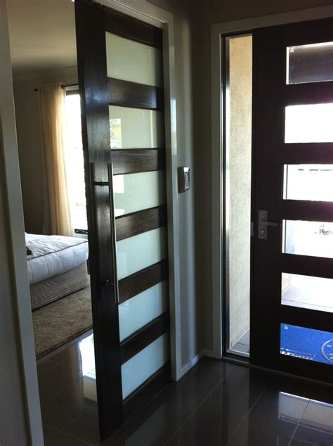 entrance door with sliding door to master bedroom
