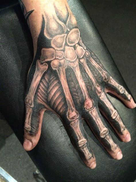 hand bone tattoo skeleton by alex frew at axonic inkworks i