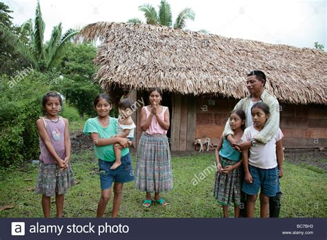 buying a house with another person painet jj1592 family people house person children guatemala mayan stock photo royalty