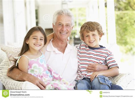 grandfather with grandchildren at home stock image image