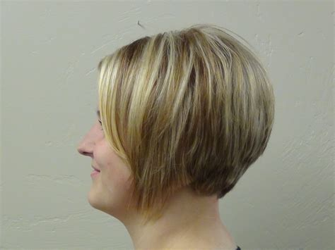 ladies short haircut to make hair look thicker thicken hair with a line haircut or bob cut hairstyle