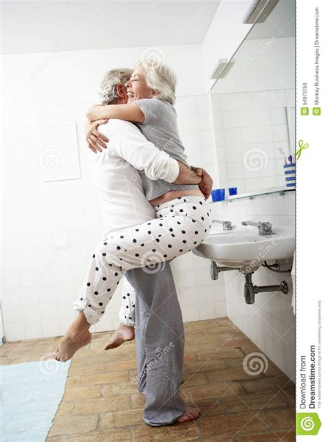 bathroom use control bdsm romantic senior couple in bathroom stock photo image