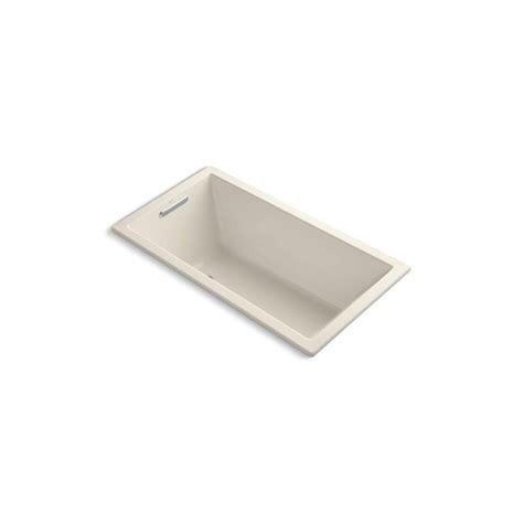kohler underscore bathtub kohler underscore 5 ft reversible drain bathtub in almond