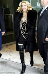 madonna steps out in boots after kicking up