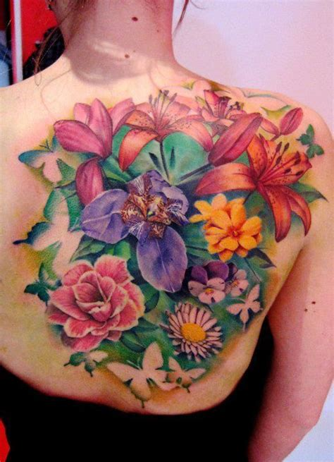 colorful flower garden on back tattoos