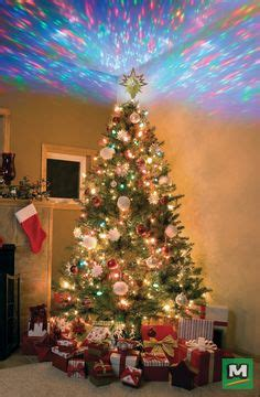 large firework effect christmas tree topper decorate your home for the holidays with this 4 5 foot prelit pine tree deck the halls