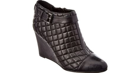 Vince Camuto Quilted Boots by Vince Camuto Loore Quilted Wedge Boots In Black Lyst