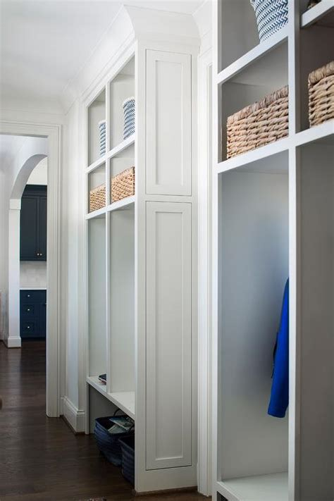 mudroom shelves blue woven mudroom bins transitional laundry room
