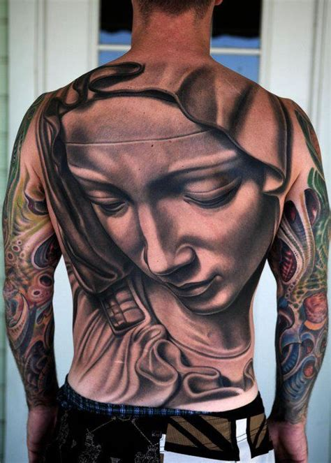 black and grey tattoo la la pieta back piece done in black and grey by nikko