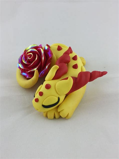 Handmade Polymer Clay - handmade polymer clay sleeping with a yellow