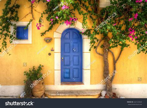 yellow house with blue door yellow house blue door asos stock photo 222123424