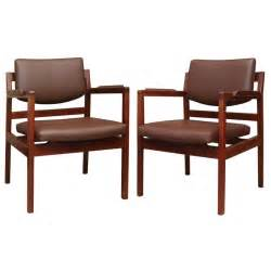 set of 8 jens risom leather dining chairs on solid walnut
