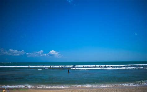 surfing  kuta beach bali   timers cost