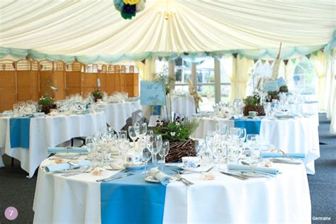 blue wedding theme ideas white linens w blue runners and a touch of gold incorporated in the
