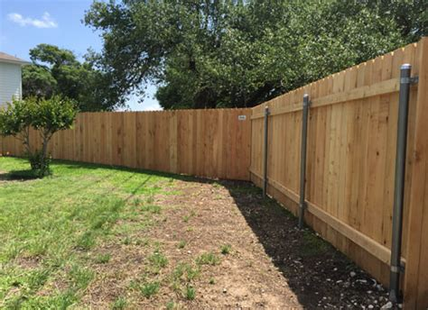 Backyard Metal Fence by Wood Privacy Fences Rock Cedar Park