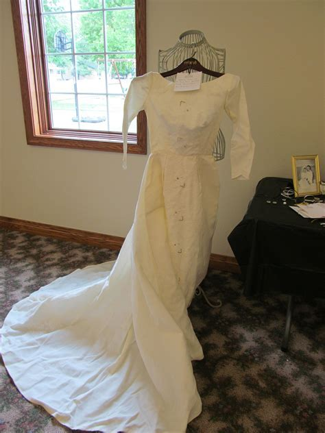 We displayed Mom's wedding dress at my parent's 50th