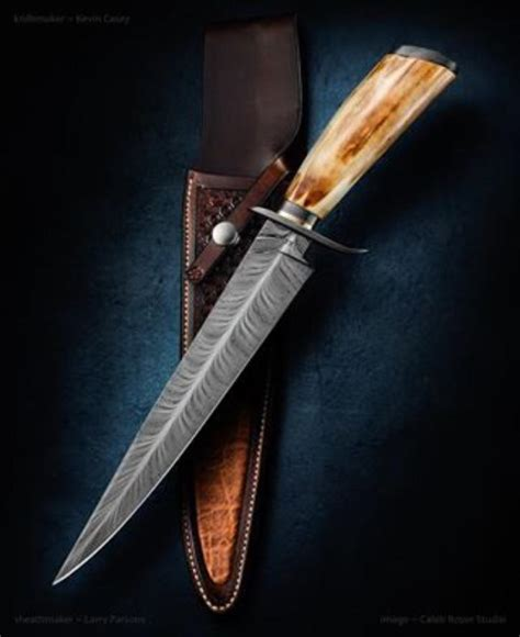 by artist r m custom knives kevin casey feather damascus