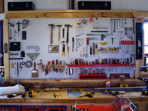 organization tools pegboard wall above the workbench can t wait to organize