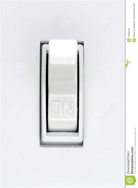 house electric light switch in on position stock photo