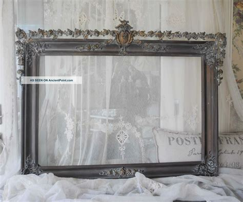 large rectangle mirror with gray steel frame placed on the