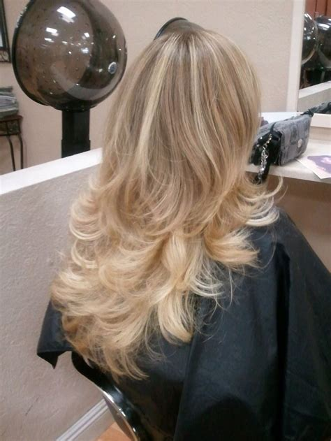 hairstyle pictures of perimeter layers long layers blown out with a round brush hair done by