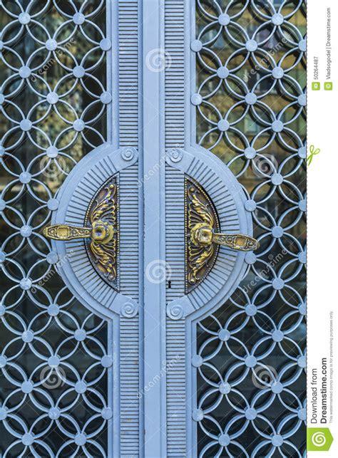 Golden Doors by Golden Vintage Door Handles On Glass And Blue Metal