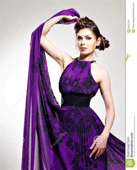 Gorgeous Fashion by Beautiful Fashion In Purple Dress Stock Photo