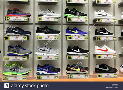 shopping of sports shoes nike running shoes for sale in a sports direct shop
