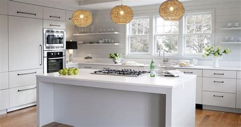 this inviting kitchen features flat front white cabinets modern cottage kitchen features white flat front cabinets