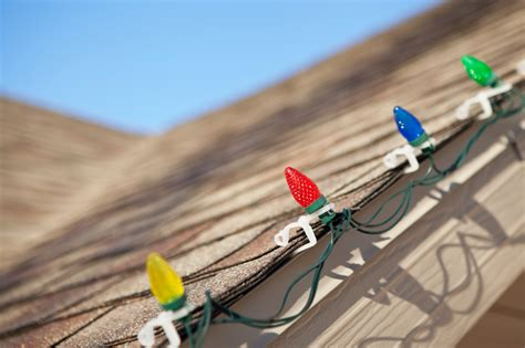 how to hang lights outside with outbusing nails 3 tips for hanging lights on your roof without damaging it