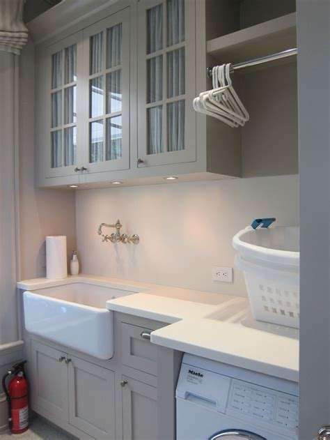 grey laundry room 25 best ideas about grey laundry rooms on utility room designs utility cabinets