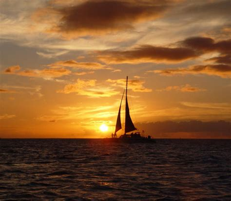 sailboat in sunset hawaian sunset with sailboat painting by laurie golden