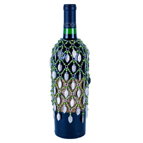 green beaded wine bottle cover or skirt with silver leaves