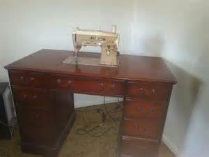 antique singer sewing machine in wood cabinet baltimore