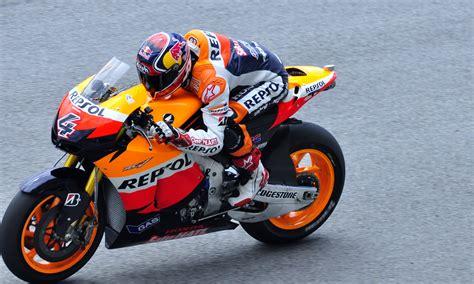 motorcycle racing gear in repsol orange white and blue motorcycle racing gear