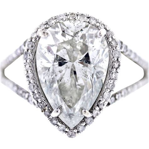white gold pear shaped halo style pave engagement ring