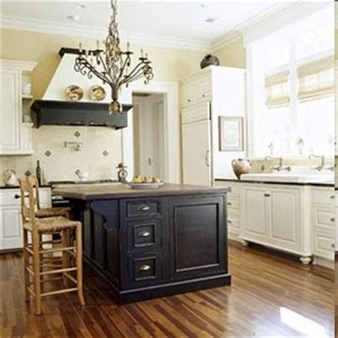 white kitchen cabinets with black island create kitchen