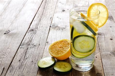 Lemon And Cucumber Detox Water Reviews by Lemon Cucumber Detox Water In A Glass Rustic Wood