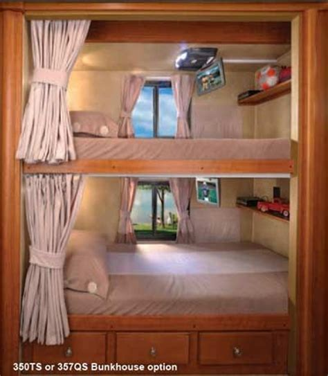 Forest River Georgetown class A motorhome bunks drop down tvs and built in shelves   River House
