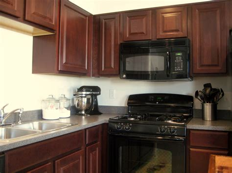 dark kitchen cabinets with black appliances backsplash goes black cabinets home design inside