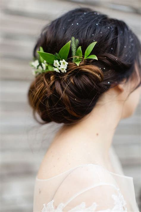 bridal hairstyles low bun with flowers brides with buns juno and joy