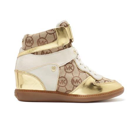 kors sneakers lyst michael kors nikko high top wedge sneakers in metallic