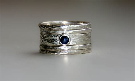 rustic rings set with blue sapphire in sterling