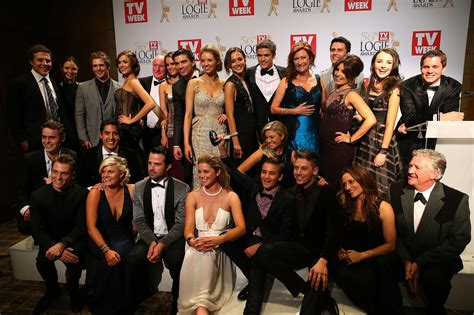 the cast and crew of home and away in the winners room