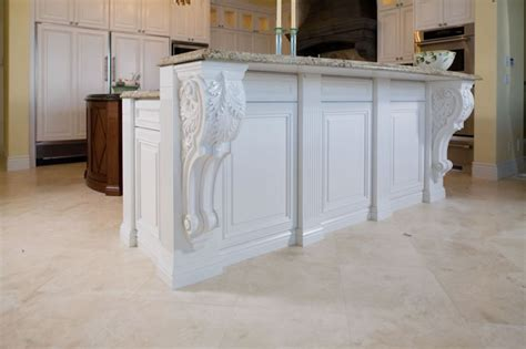 corbels for kitchen island traditional painted island cabinets with carved corbels
