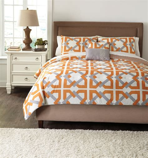 orange comforter queen zaya orange queen comforter set from ashley q441005q