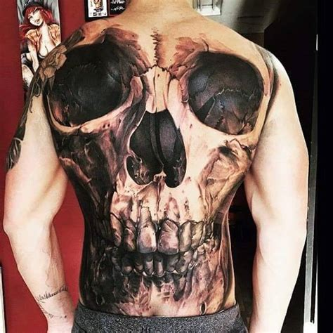 skull back tattoos black and grey skull on back